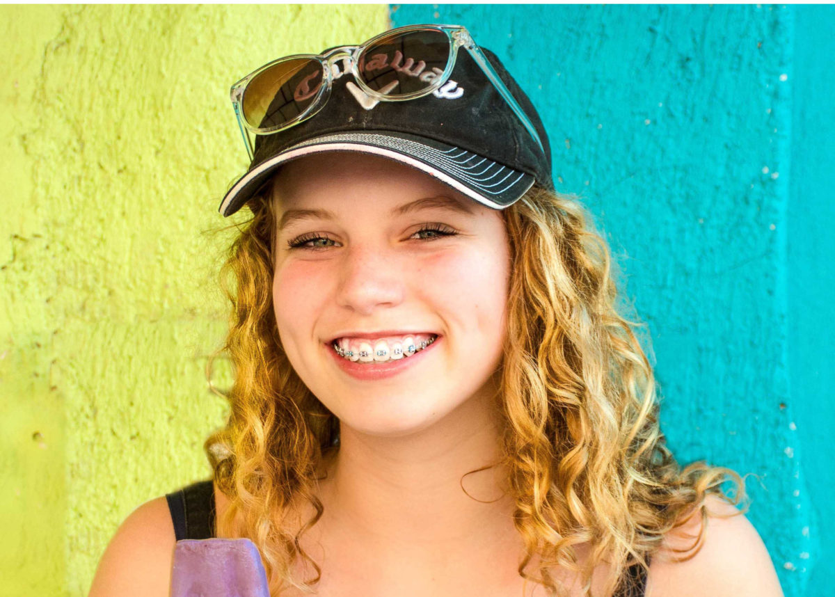 Teen in hat shows off her braces